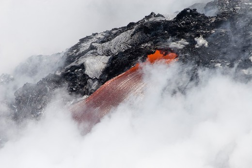 Stock Photo: 1916-6203 Hawaii, Volcanos National Park, steam cloud nearly hides this lava flow pouring into Pacific Ocean