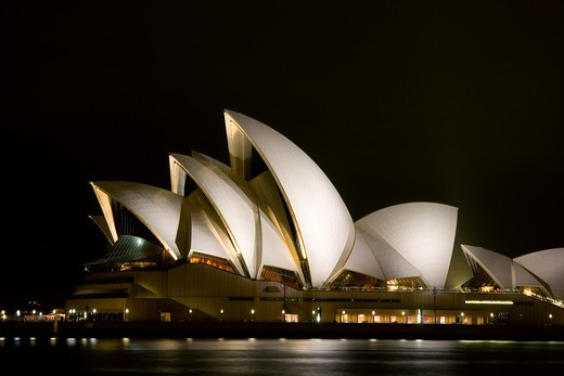 Australia, Sydney, night lit scene looking across Sydney Harbor to iconic Opera House : Stock Photo