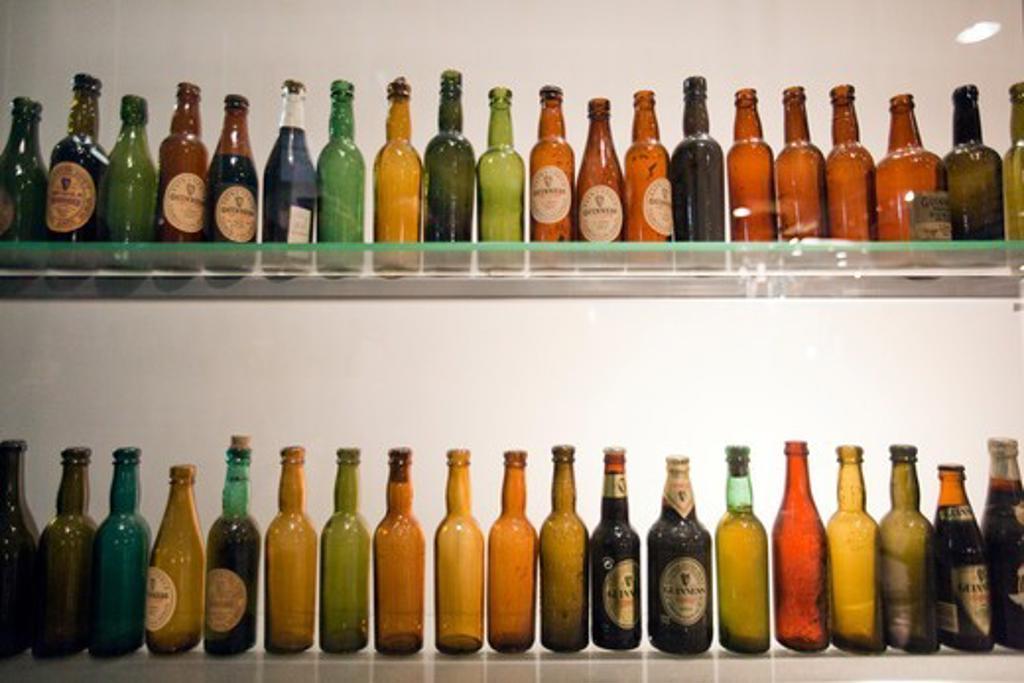 Stock Photo: 1916-7598 Ireland, Dublin, Beer bottles exhibited at Guinness storehouse