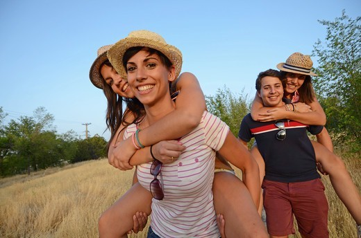 Young group of three women and  man play in nature : Stock Photo