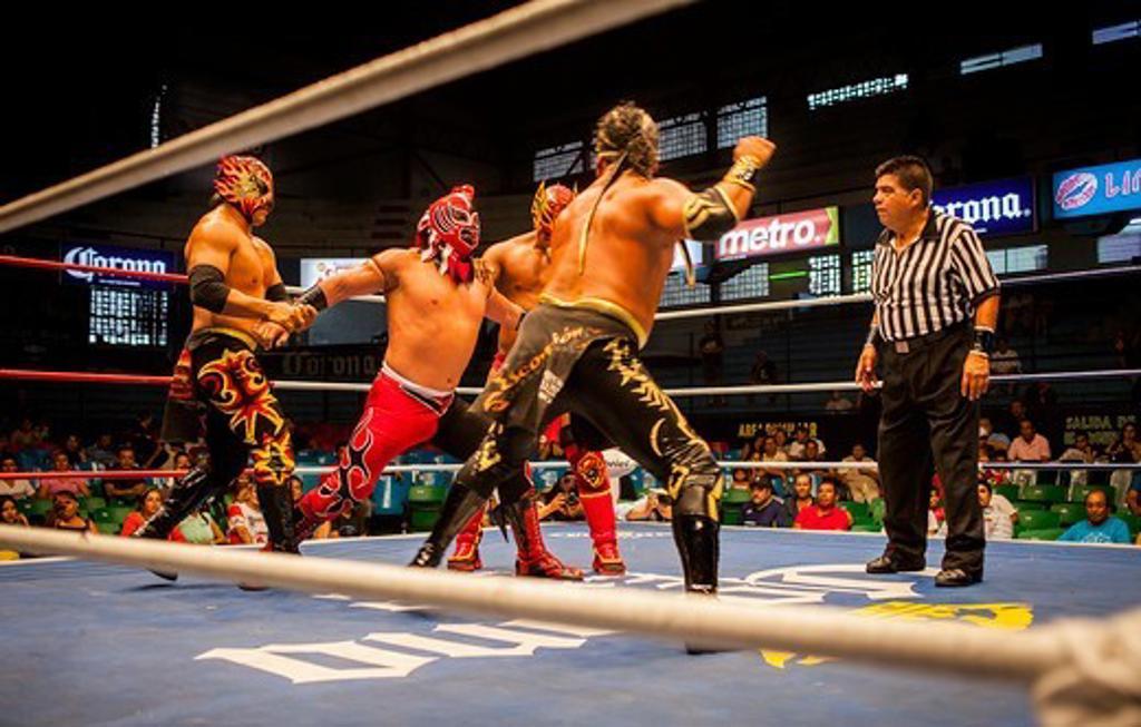 Stock Photo: 1916-9576 Wrestlers perform in a Lucha Libre event in Guadalajara Arena Coliseo,Guadalajara, Jalisco, Mexico