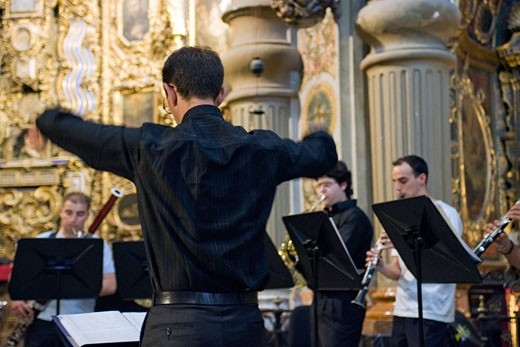 Classical music conductor during a concert in San Luis de los Franceses church  Seville  Spain : Stock Photo