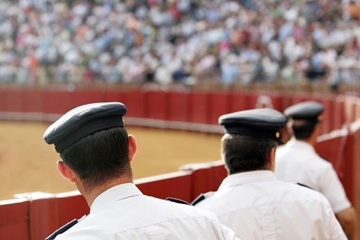 Stock Photo: 1925-1109 Spanish policemen watching a bullfight Taken during a bullfight at the Real Maestranza bullring  Seville  Spain  on 15 June 2006