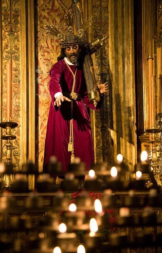 Stock Photo: 1925-1150 Votive candles for Nuestro Padre Jesus con la Cruz al Hombro Our Father Jesus Bearing the Cross  Anunciacion church  Seville  Spain