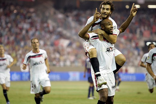 Stock Photo: 1925-1171 Kanoute and his fellows celebrating a goal Taken at Sanchez Pizjuan stadium Seville  Spain on 29 August 2006 during the Spanish Liga game between Sevilla FC and Levante UD The final score was 4 0 for Sevilla  the home team
