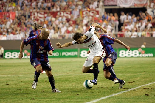 Stock Photo: 1925-1179 Antonio Puerta dribbling opponent players Taken at Sanchez Pizjuan stadium Seville  Spain on 29 August 2006 during the Spanish Liga game between Sevilla FC and Levante UD The final score was 4 0 for Sevilla  the home team