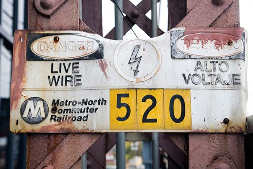 Stock Photo: 1925-1300 Warning sign of live wire in English and Spanish  CT  USA
