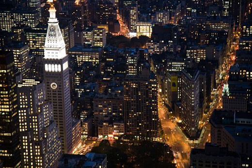 The Flatiron building and the MLIT by night from the Empire State Building  NYC  USA : Stock Photo