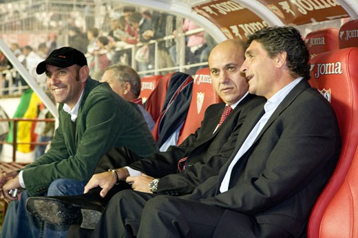 From left to right  Monchi  Del Nido and Juande Ramos sitting on the Sevilla FC bench Taken at Sanchez Pizjuan stadium Sevilla  Spain on 18 November 2006 during the Spanish Liga game between Sevilla FC and Valencia CF : Stock Photo