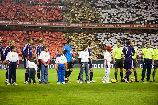 Stock Photo: 1925-1440 Real Madrid players forming with children before the game Taken at Sanchez Pizjuan stadium Seville  Spain on 9 December 2007 during the Liga game between Sevilla FC and Real Madrid The final score was 2 1 for Sevilla  the home team