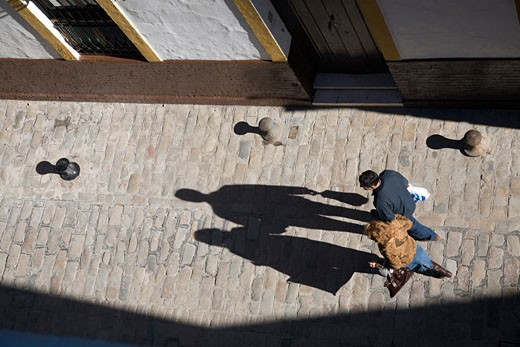 Stock Photo: 1925-1462 Aerial view of a couple walking on the street  Seville  Spain