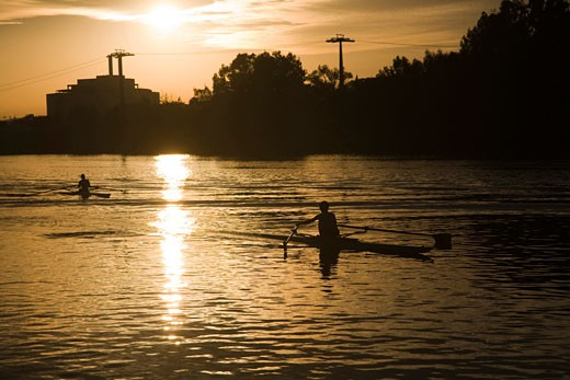 Stock Photo: 1925-1478 People rowing on Guadalquivir river at sunset  Seville  Spain