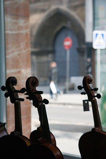 Silhouette of violins on the window of a musical instruments store  Seville  Spain : Stock Photo