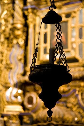 Stock Photo: 1925-1552 Lamp with a candle  San Luis de los Franceses church  Seville  Spain
