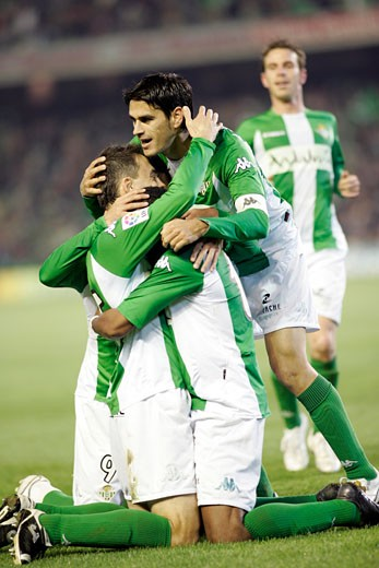 Real Betis players embracing after a goal scoring Taken at Ruiz de Lopera stadium Seville  Spain  during the Spanish Liga game between Real Betis and FC Barcelona which took place on 24 January 2007 The final score was 1 1 : Stock Photo