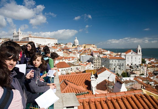 Portuguese students looking at Lisbon from Santa Luzia viewpoint : Stock Photo