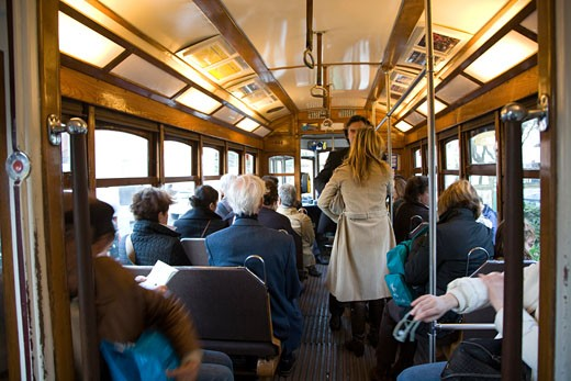 People traveling in a tram  Lisbon : Stock Photo