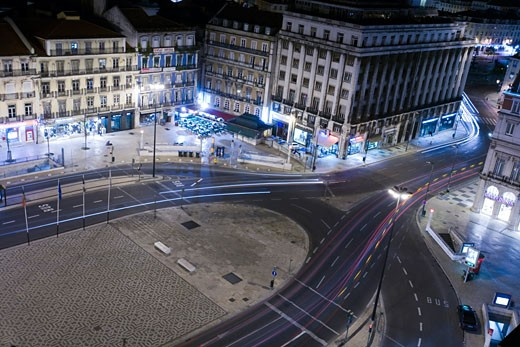 Nocturnal view of Restauradores square  Lisbon : Stock Photo