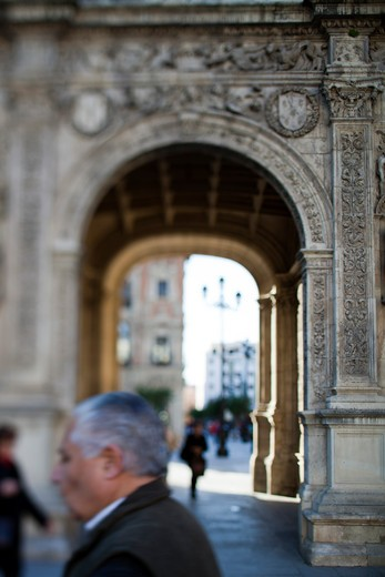 People near an archway, City Hall Archway, Seville, Andalusia, Spain : Stock Photo