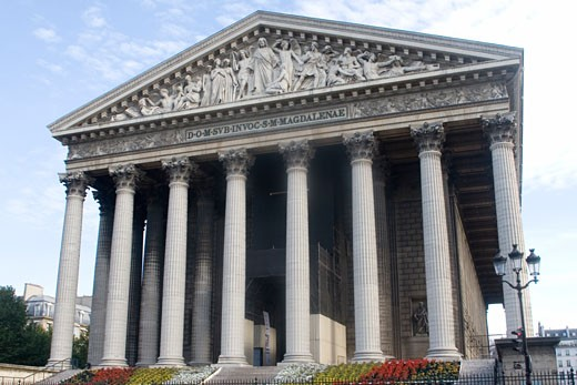 Church of St Mary Magdalen know as The Madeleine modelled after the Partheon Paris France : Stock Photo