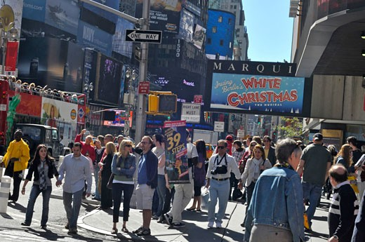 Times Square a New York landmark for tourists and visitors home of the Broadway show musicals : Stock Photo