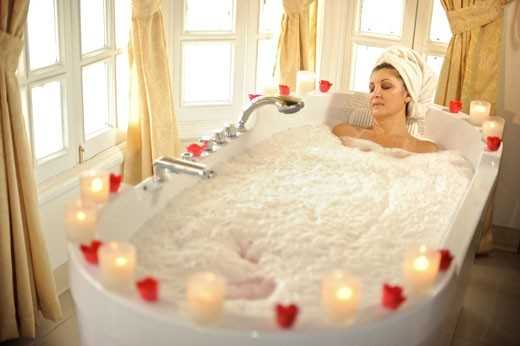 Imperium Spa and Medical Center offers Panamenians and International visitors health beauty and relaxation treatments in Obarrio around 58th Street incorporating the latest technologies Pictured   photo of a woman relaxing on a jacuzzi bath : Stock Photo