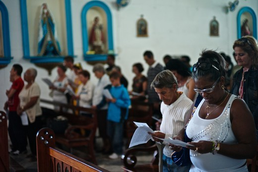 Stock Photo: 1933-7130 Cuba, People praying in Igleasia de Nuestra Senora de Regla