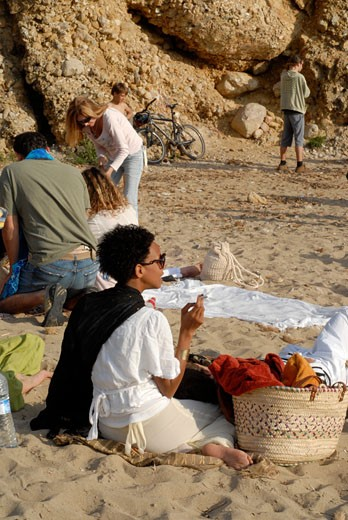 People enjoying sundays in popular Benirras beach  where drum players play until sunset  Ibiza  Spain : Stock Photo