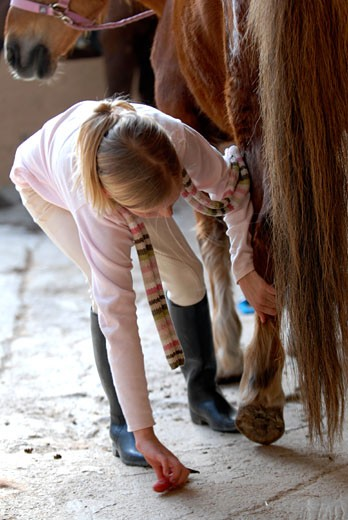 Kids and horses in Can Mayans Ibiza Spain : Stock Photo