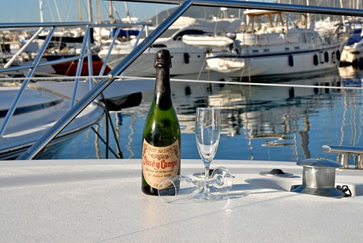 Stock Photo: 1938-1682 Cava bottle and two cups on the front side of a luxurious yacht in Ibiza Spain