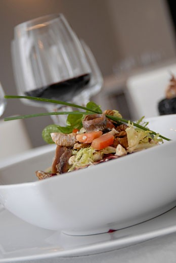 Creative and colorful salad and cup of wine in El Hall restaurant Ibiza : Stock Photo