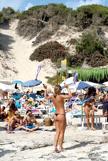 People enjoying sun and beach next to popular Sa Trinxa  in Salinas  Ibiza : Stock Photo