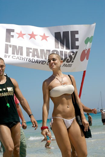 Stock Photo: 1938-2096 Sexy attractive young people doing promotion of Pachas David Guetta Fck me Im famous party in Salinas beach  Ibiza  Spain