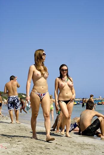 Topless Women Taking A Walk In Salinas Beach Ibiza Spain -6320