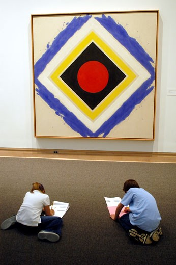 NEW YORK CITY Couple of children sitting on the floor and trying to draw a copy of an acrylic on canvas named Magic Box  by american artist Kenneth Noland  in the Metropolitan Museum of Art of New York : Stock Photo