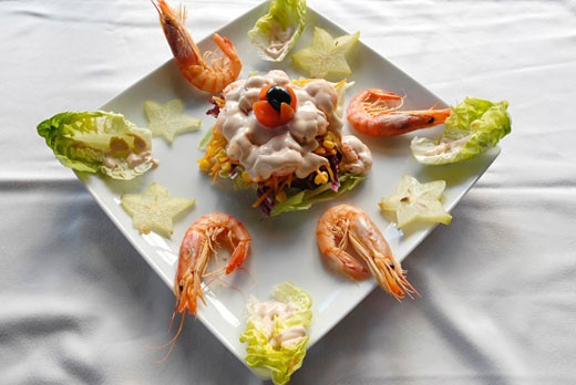 Salad by Nano Calvo Salad with lettuce shrimps pineapple and pink sauce : Stock Photo