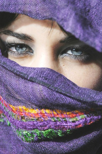 Model Released Attractive young  woman with clear blue eyes with her face covered : Stock Photo