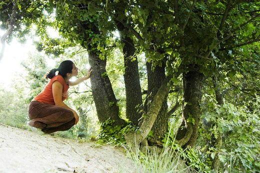 Stock Photo: 1938-3036 Spain, Barcelona, Young woman relaxing in nature