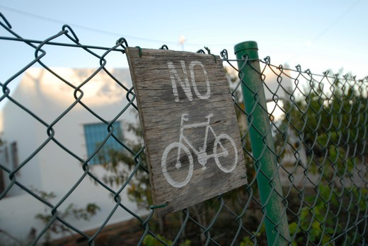 Stock Photo: 1938-3040 No Bicycle sign on a chainlink fence, La Mola, Formentera Island, Balearic Islands, Spain