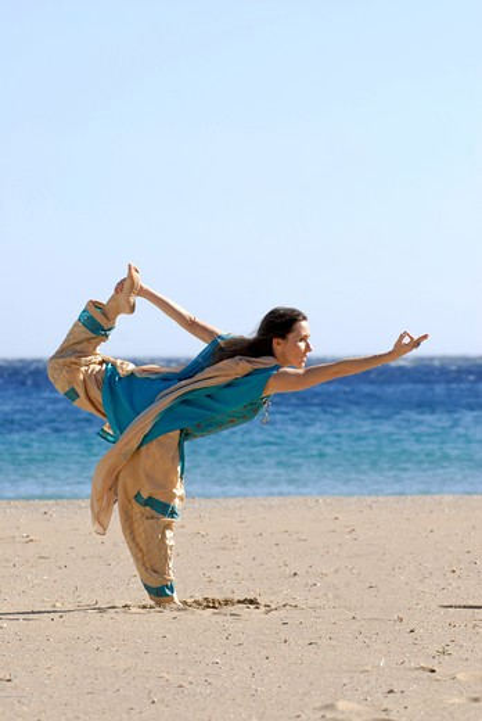 Stock Photo: 1938-3138 Yoga teacher and artist Lena Tancredi doing yoga on the beach, Ibiza Island, Balearic Islands, Spain