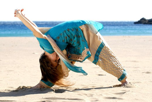 Yoga teacher and artist Lena Tancredi doing yoga on the beach, Ibiza Island, Balearic Islands, Spain : Stock Photo