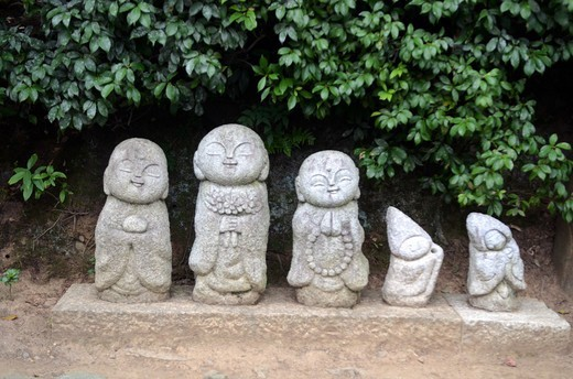 Stock Photo: 1938-3258 Shinto figures in a garden at Arashiyama, Kyoto Prefecture, Honshu, Japan