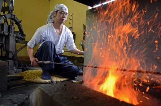 Japan, Saitama, Japanese Sword Blacksmith working at his workshop : Stock Photo