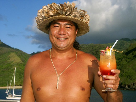 Stock Photo: 1940-1014 Yo yo Laifon  bartender aboard the expedition ship Aranui III  toasts with one of his special tropical cocktails  Marquesas