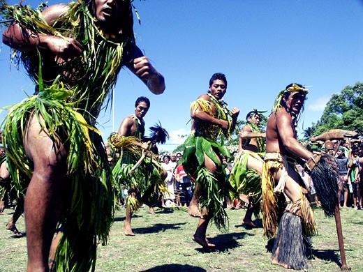A Marquesan island dance group demonstrates an island war dance : Stock Photo