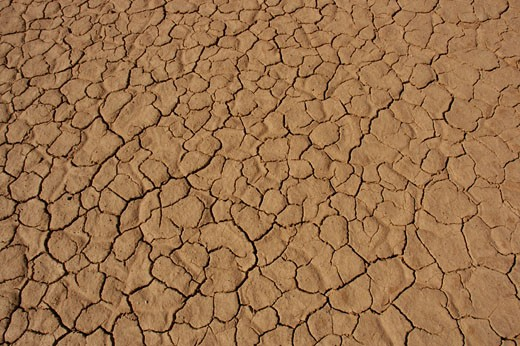 Cracked ground because of the drought Death Valley National Park United States : Stock Photo
