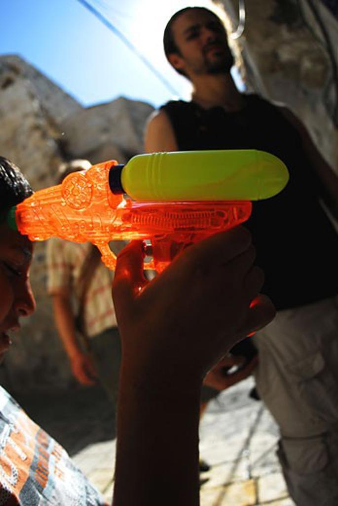 Kid playing with gun  Jerusalem : Stock Photo