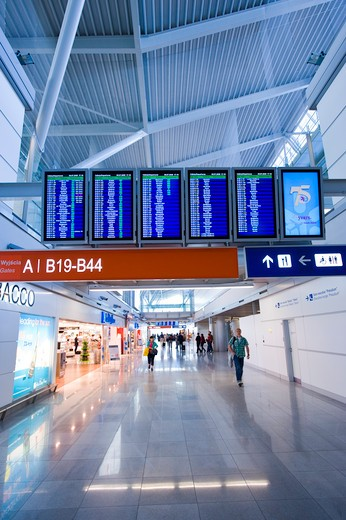 Poland, Warsaw, Fryderyk Chopin Airport, walkway with signs : Stock Photo