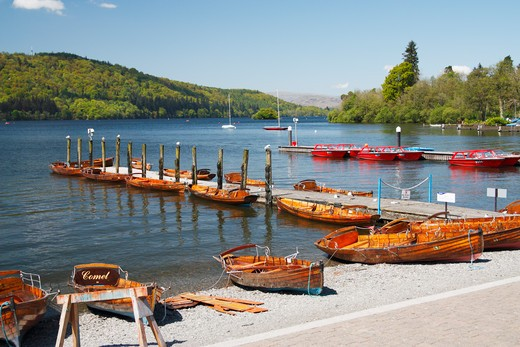 Boats for hire near a pier, Bowness-On-Windermere, Lake District, Cumbria, England : Stock Photo