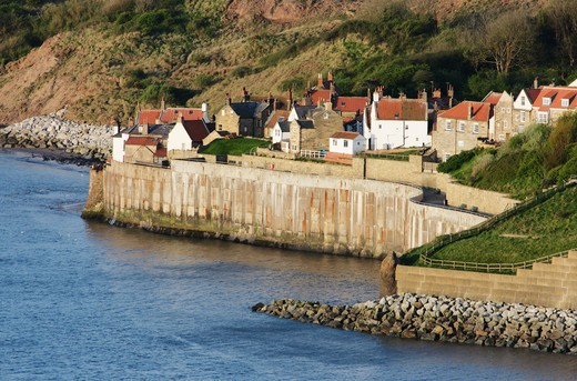 Town at the waterfront viewed from the Cleveland Way, Robin Hood's Bay, Scarborough, North Yorkshire, England : Stock Photo
